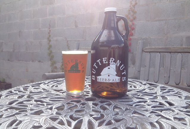 Butternuts growler and pint of beer