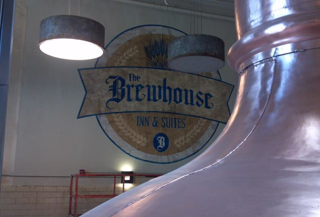 brewhouse inn sign and brewing vat