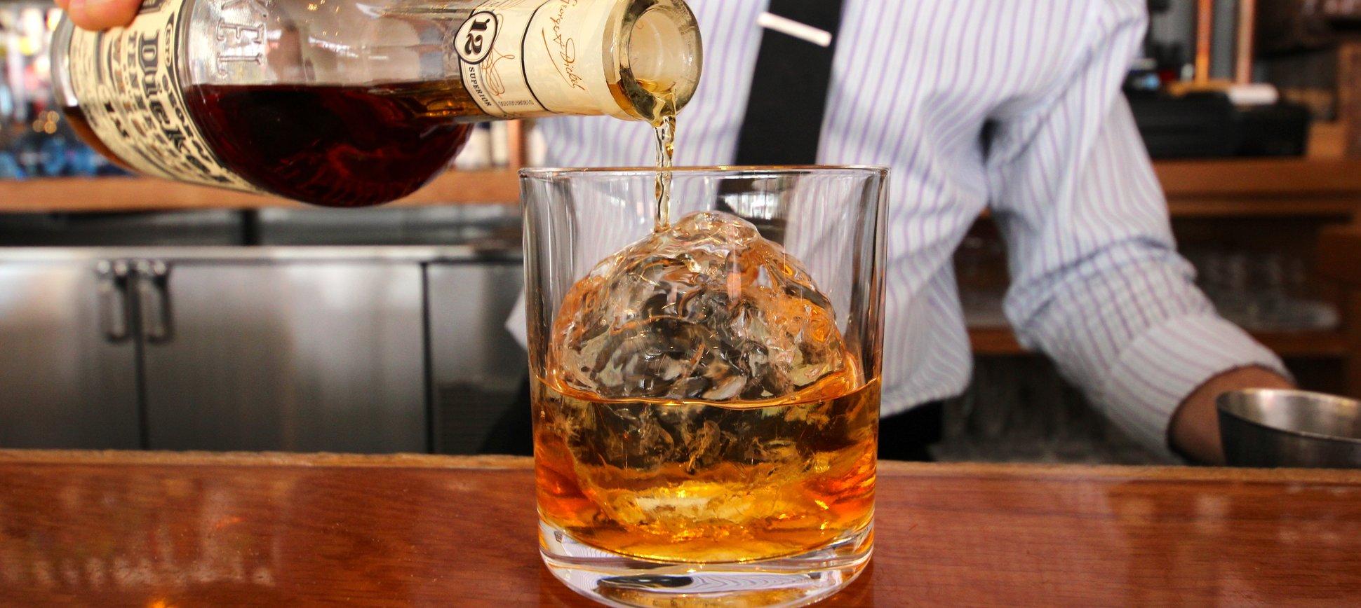 bartender pouring whiskey