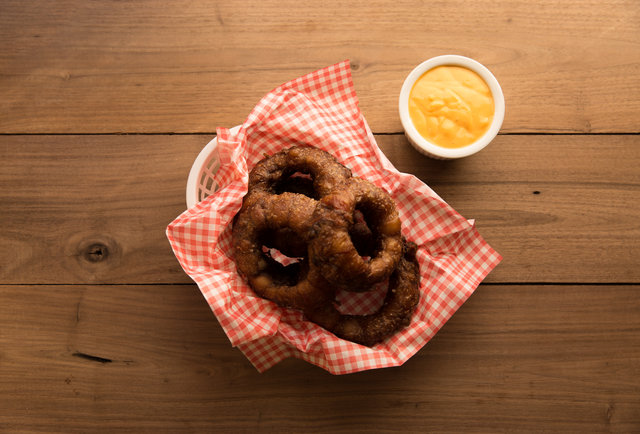 Bacon-Wrapped, Stout-Battered Onion Rings Make You a Better Person