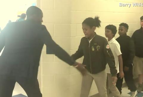 This teacher has a personalised handshake for every student!