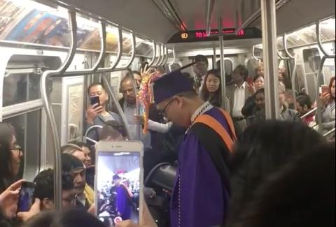 Passengers create impromptu graduation ceremony for student stuck on subway