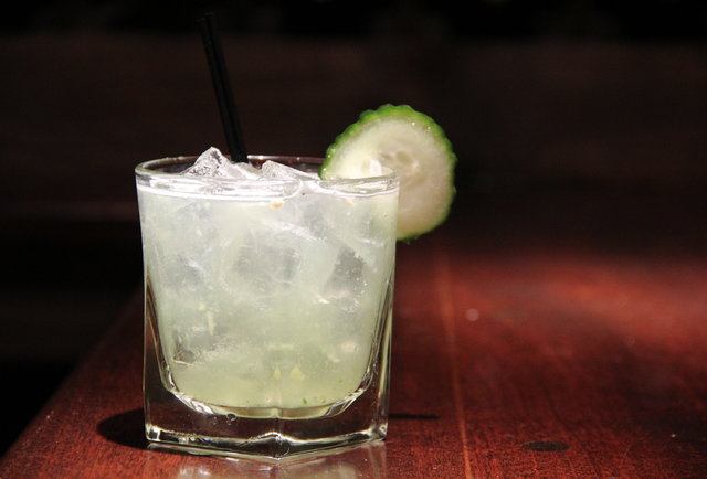Cocktail with a cucumber garnish