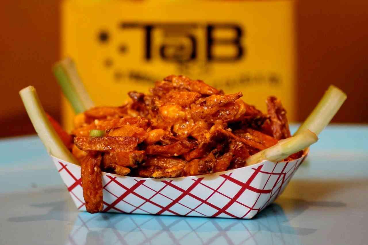 Buffalo-sauced fries w/ celery