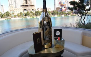 Control the Bellagio fountains while drinking an 8-gallon bottle of bubbly