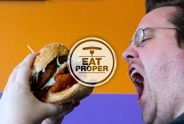 Editor Bradley Foster chows down on a huge sandwich-The Best Restaurants in Seattle
