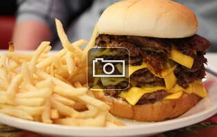 A Thrillist editor taste-tests Steak & Shake's seven-patty, 1330-calorie burger