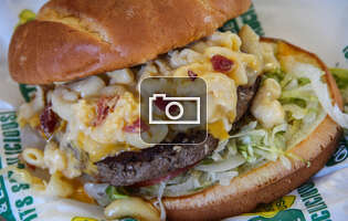This burger has bacon mac 'n cheese on it. Yep.
