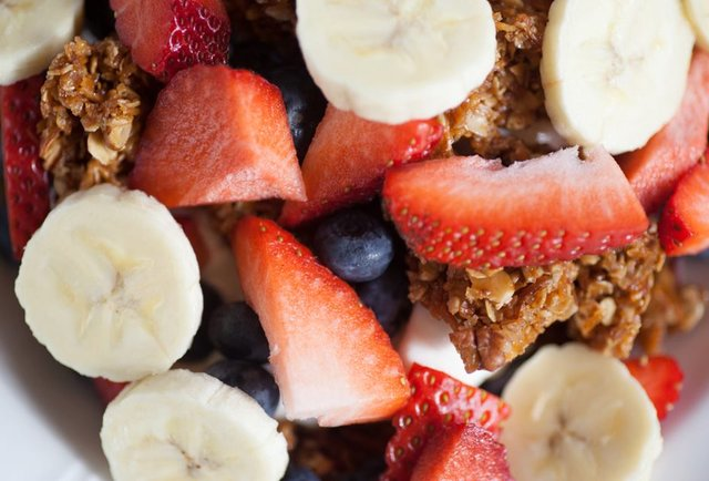Granola with strawberries, bananas and blueberries