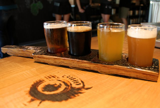 A paddle of beers at Griffin Claw Brewing Company