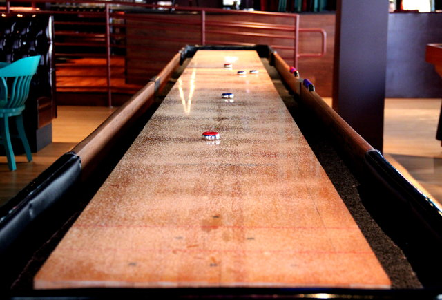 Shuffleboard at GGTR-A bar-gaming paradise with 100 beers, potato chip nachos, and pinup girls