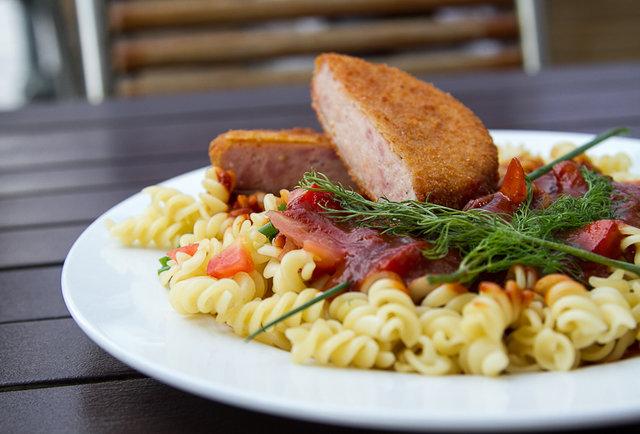 Schnitzel dish over pasta