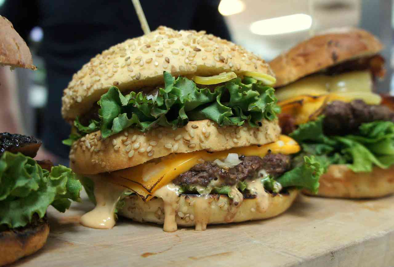 Large melty burger with lettuce