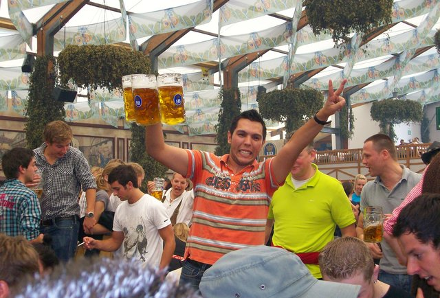 Happy dude holding up beer