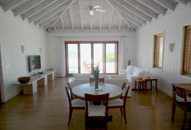 One bedroom living room at Parrot Cay by COMO