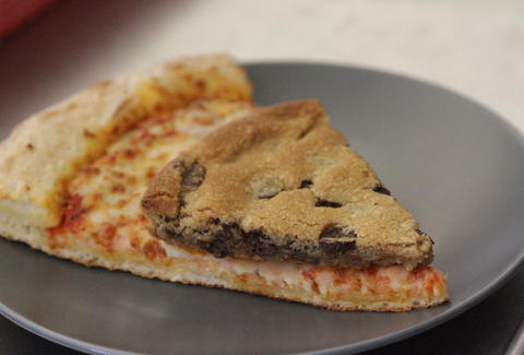 Papa John's mega chocolate chip cookie and pizza slices