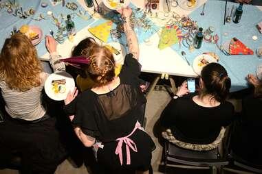 Sophia serving people at her supper club in Berlin