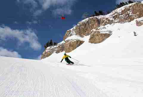 guy skiing down hill at jackson hole