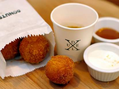 Donut holes and coffee at Delux Toronto