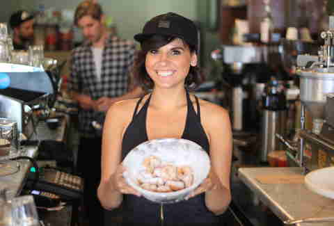 Girl with donuts at Little Nicky's Toronto