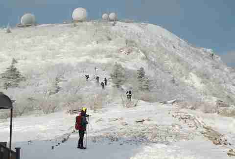 North Korean skiers and snowy mountain with radar