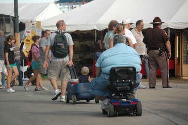 Fat dude on mobility scooter