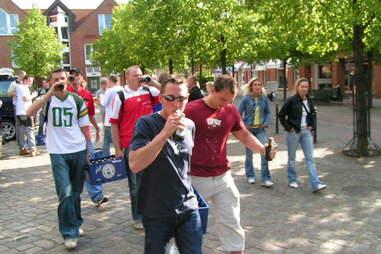 men walking with beer