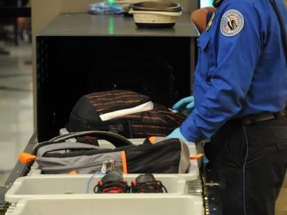 TSA security agent at airport checking baggage