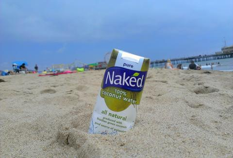 Naked coconut water on the beach
