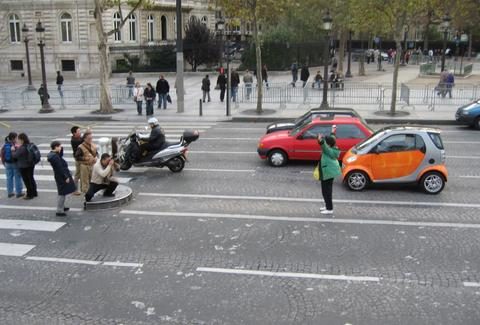tourists taking pictures in the middle of the road
