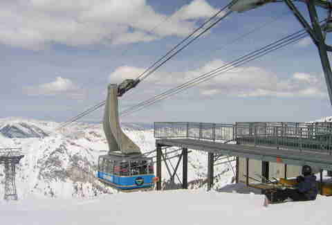 cable car going up mountain