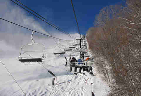 people riding ski lift