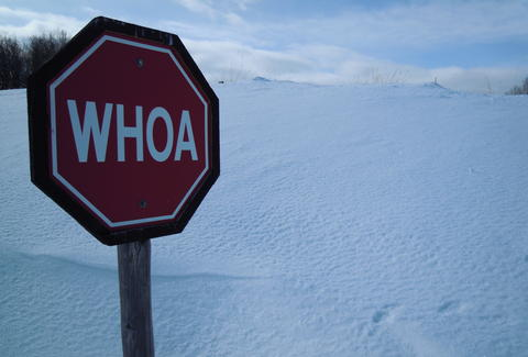 Whoa sign with snow