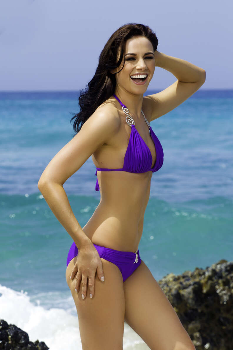 Ryanair flight attendant on beach striking pose