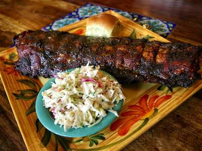 honky tonk BBQ chicago plate of ribs with coleslaw and a roll