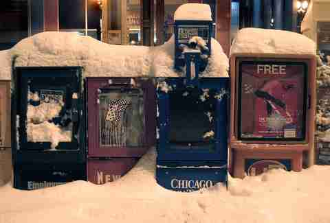Chicago newspaper boxes covered in snow