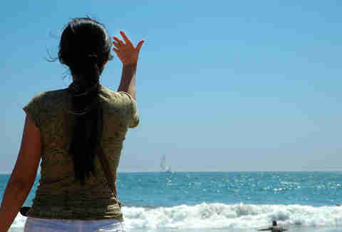 woman beckoning the sea