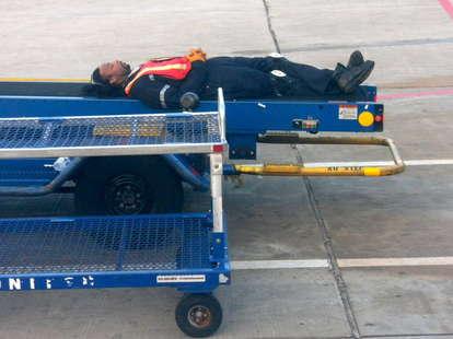 Baggage handler asleep