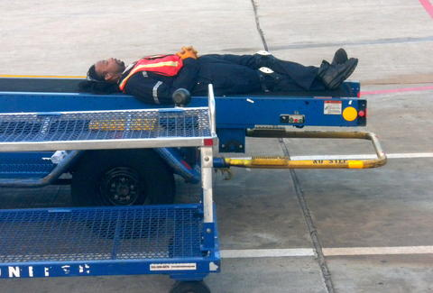 Baggage handler asleep
