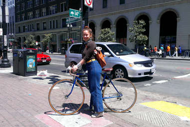 girl on bicycle at corner