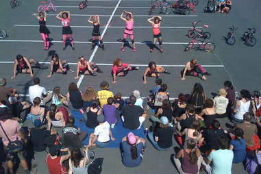 girls stretching before bicycle race