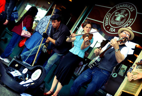 band in front of starbucks