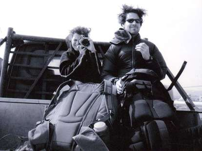Couple hitchhiking