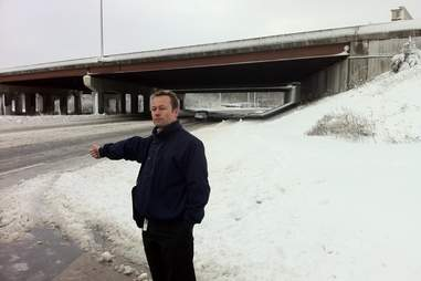 man hitching in the snow