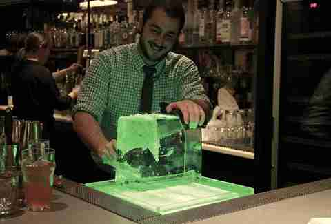 bartender cutting ice
