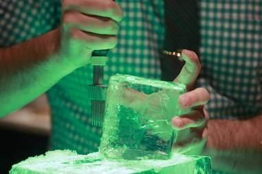 bartender cutting ice