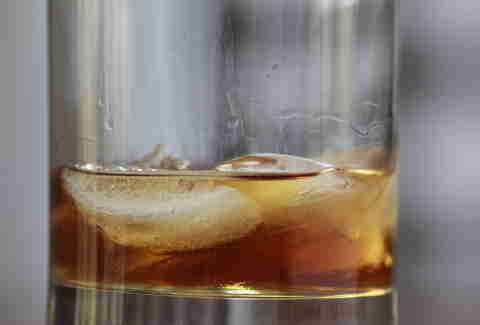 ice cubes in a bourbon drink