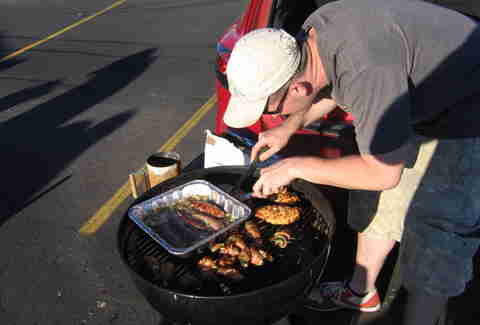 Man barbecuing at tailgate