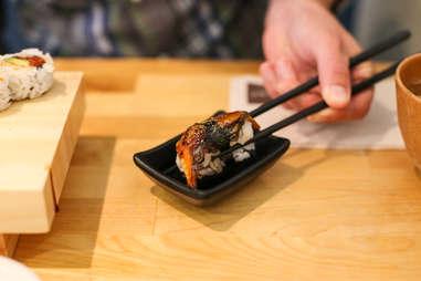 nigiri with chopsticks
