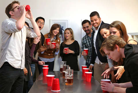 people playing flip cup